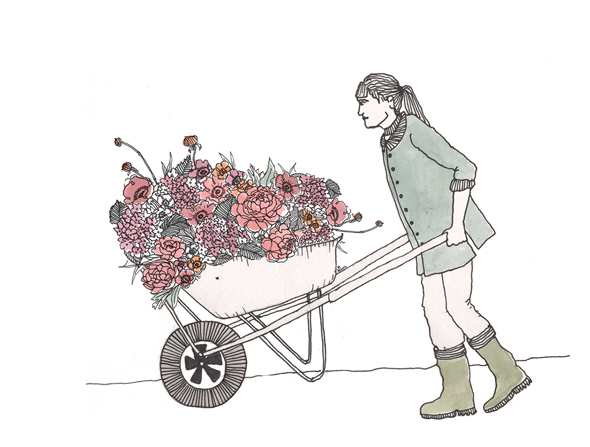 pushing wheelbarrow full of flowers